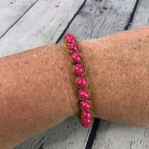 Plunder gold tone pink magnetic bead bangle